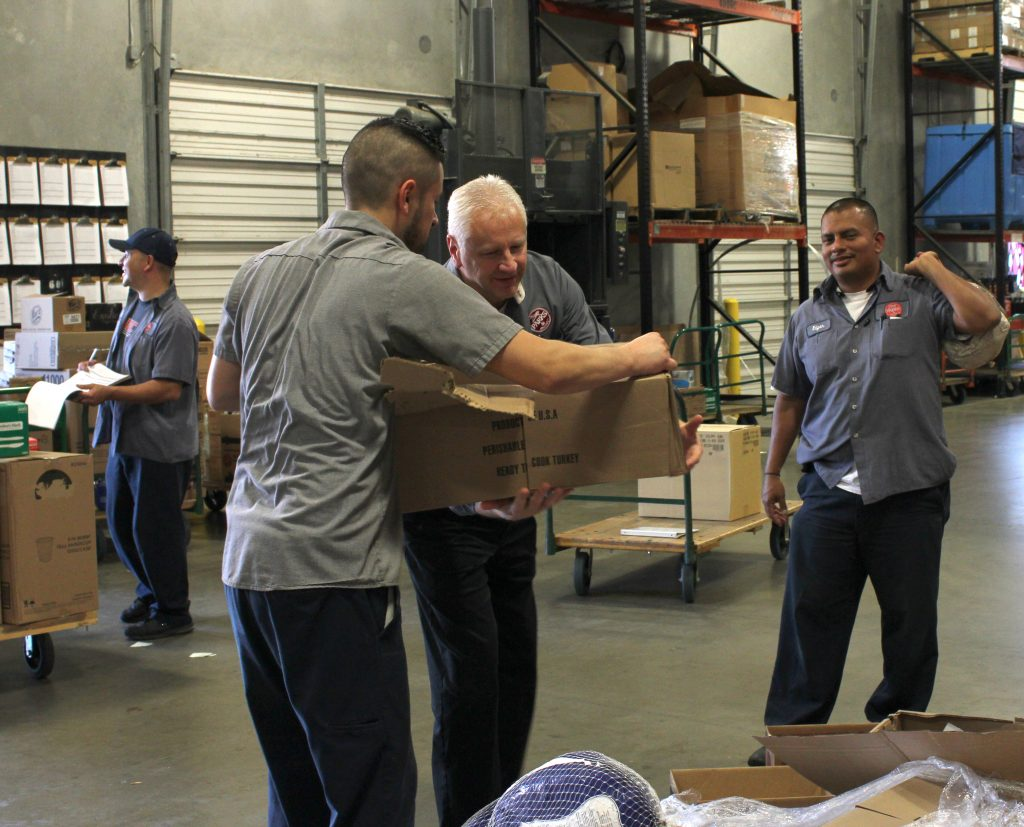 Distributing turkeys and hams to our employees in Dallas, Texas